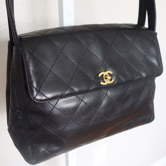 """XL Jumbo Vintage Chanel Quilted Shoulder Flap Bag 100% Authentic.  Black leather Chanel Quilted Flap Bag with dual shoulder straps, gold tone interlocking CC logo at front, single interior zipper pocket, one interior wall pocket, and front turn lock closure.  Shoulder Strap Drop 9"""", Height 9.5"""", Width 11.5"""", Depth 3.25"""" Includes dust bag.   I DO NOT TRADE MAKE ME AN OFFER CHANEL Bags"""