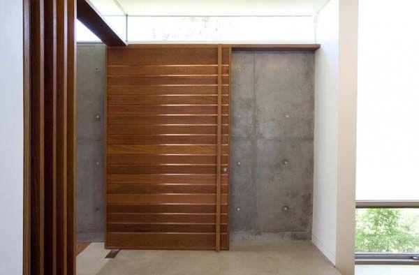 Modern wood front door a bit modern for my current taste but