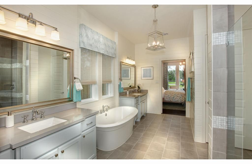 Master Bathroom With Large Tub And Double Vanity The