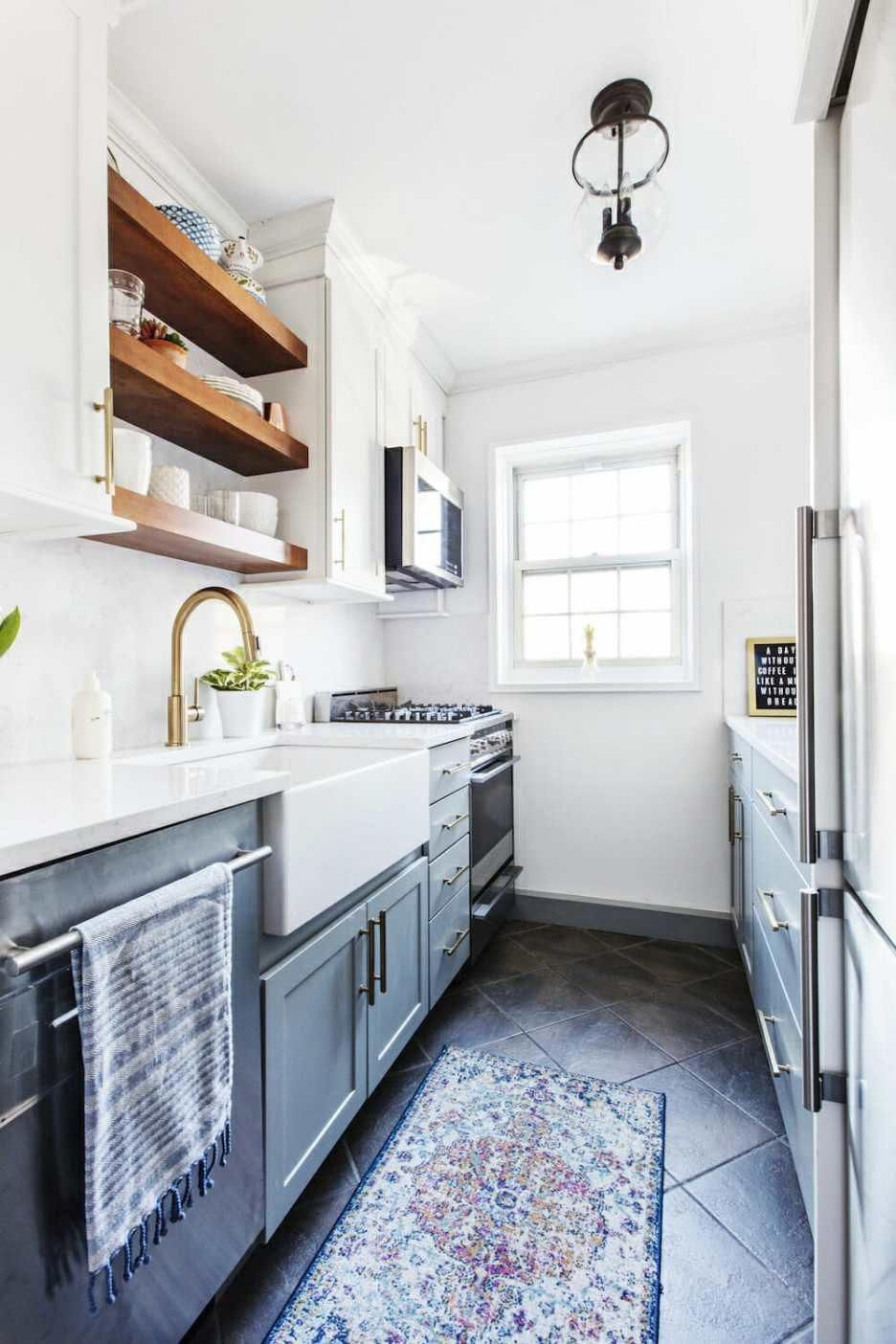 A Dark Galley Kitchen Transforms Thanks To Two Tone Cabinets Open Shelving And Mixed Met In 2020 Kitchen Remodel Small Kitchen Design Small Galley Kitchen Renovation