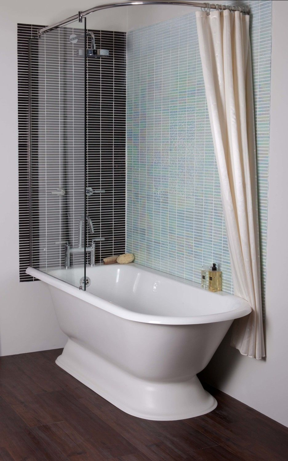 bathroom white clawfoot bathtub with glass wall partition and shower curtain plus glass mosaic