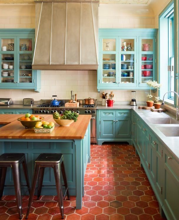 vibrant turquoise and terracotta in this expansive kitchen in a