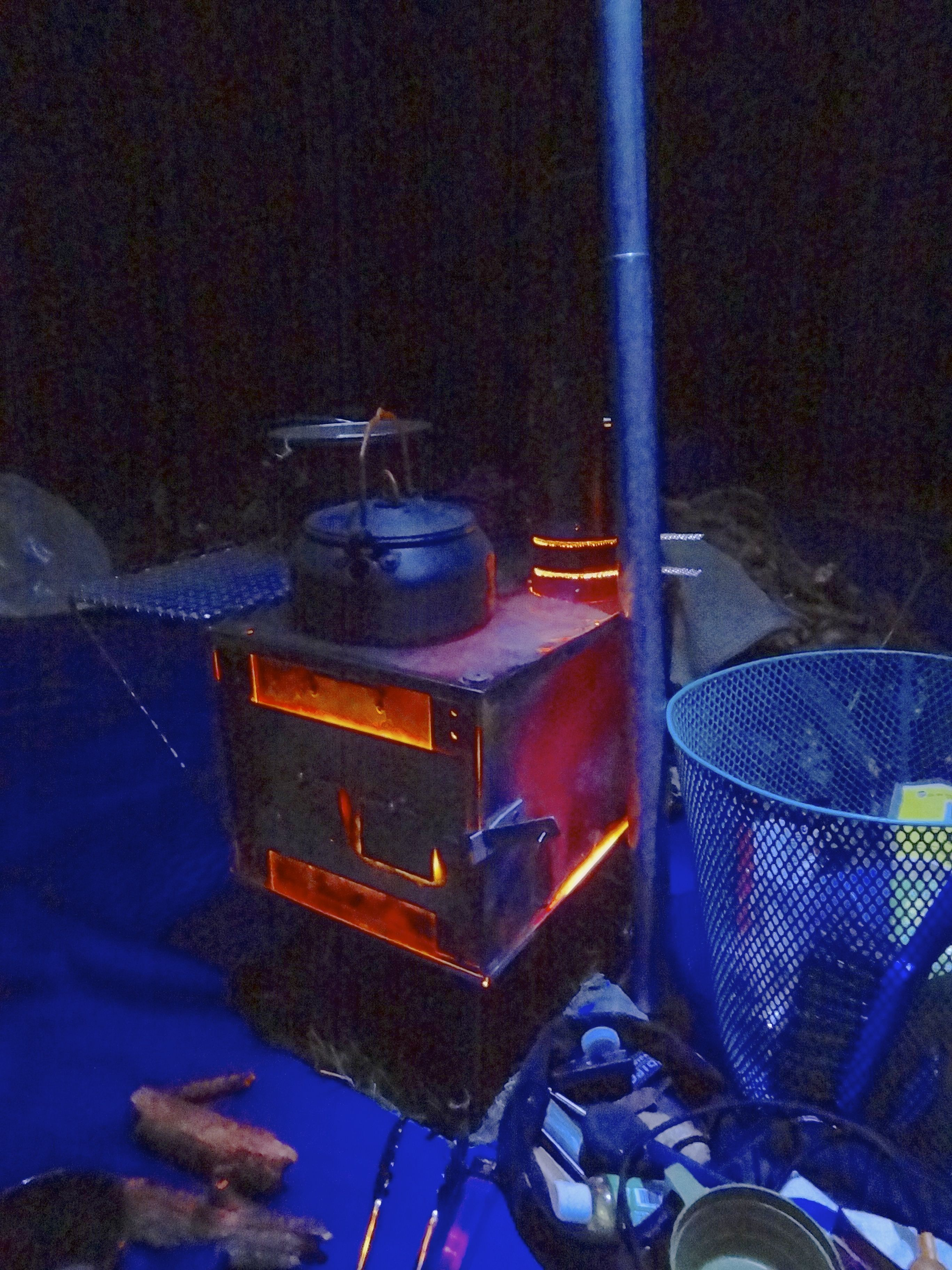 My Tipi's Titanium wood stove is a light show at night