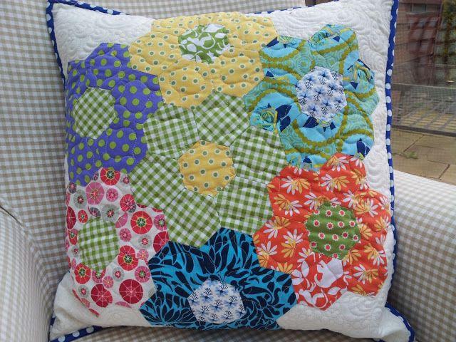 Orphan hexagon blocks as a pillow, by Longarm Chris (UK)