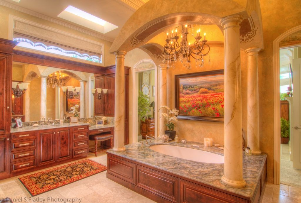 Mediterranean Master Bathroom with Chandelier, Daltile - jurastone beige 18 in. x 18 in. natural stone floor and wall tile