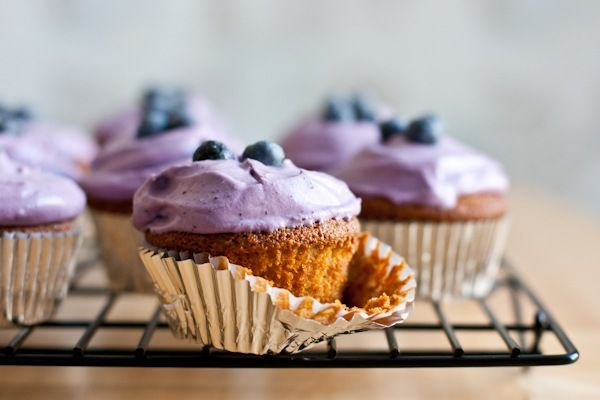 lemon almond flour cupcakes with blueberry whipped cream frosting