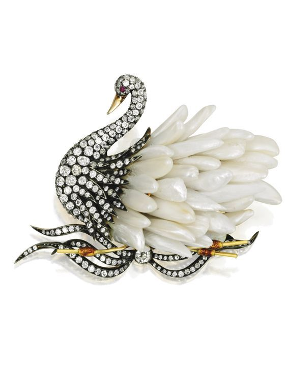Gold, Silver, Freshwater Pearl and Diamond Swan Brooch. With numerous freshwater Pearl feathers, the swan enhanced by old mine, old European and single-cut Diamonds weighing approximately 7.40 carats, accented with a Ruby eye and enameled reeds. •Lot Sold. 10,000 USD