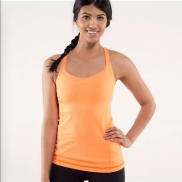 Lululemon Free To Be Tank. Size 6. Orange Lululemon Free To Be Tank. Size 4. Color on the model is accurate. Sherbet Orange. I don't know why my camera can not capture the color. Is much brighter than photos. Worn 3 times. Like new. lululemon athletica Tops Tank Tops