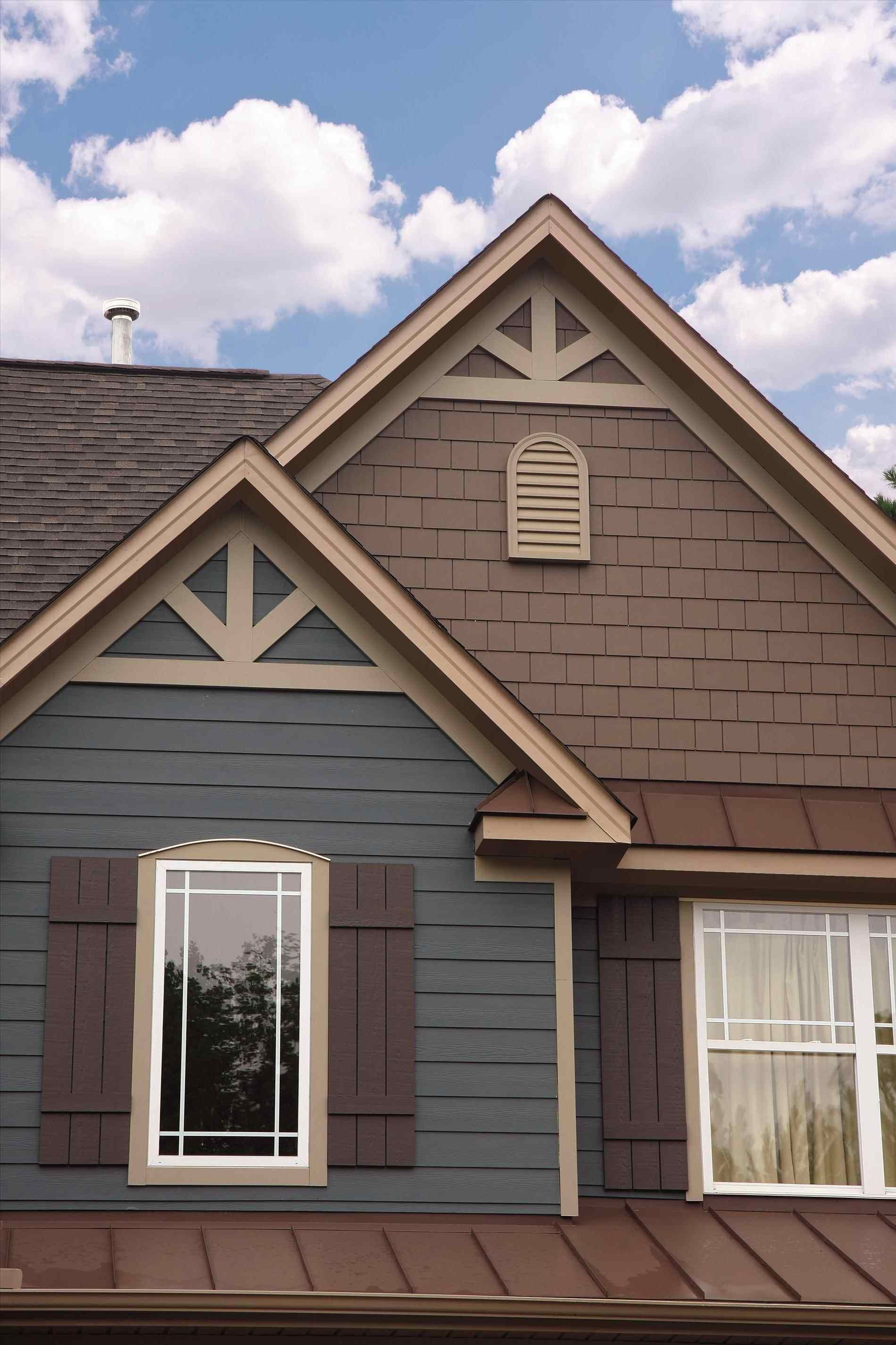 Tan Trim On Dark Blue To Complement The Tan Brick Exterior