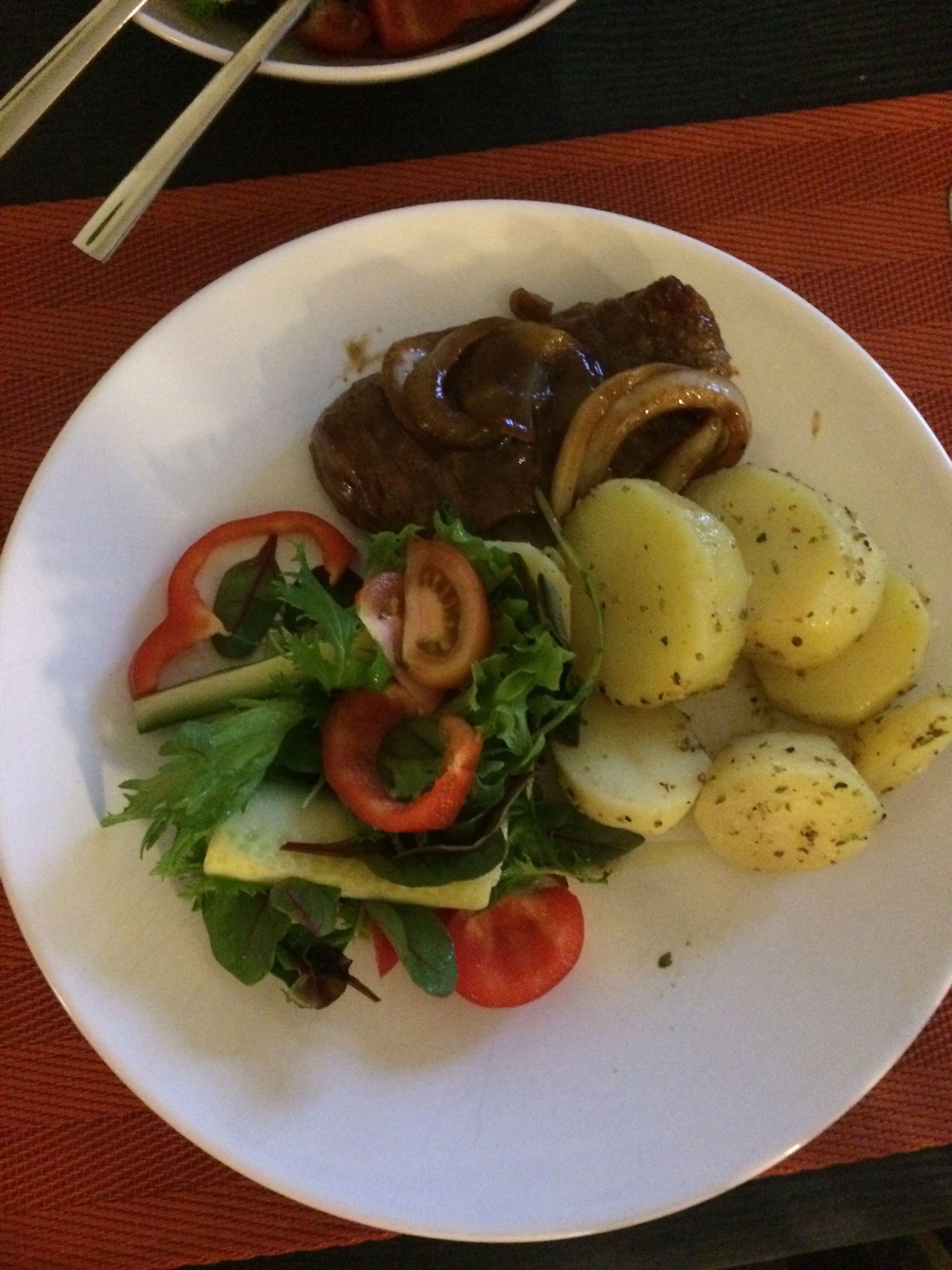 Meat with sautéed potatoes and salad
