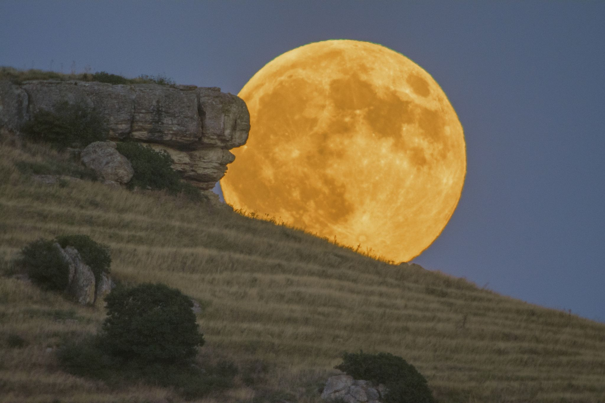 The rocks on the left are seem to create a face looking at the face of the full Moon as its Autumn is looking face to face with Summer. Excellent weather conditions during this imaging session and a magnificent full moon is rising over the Megalithic monument of Horigio - Northern Greece.