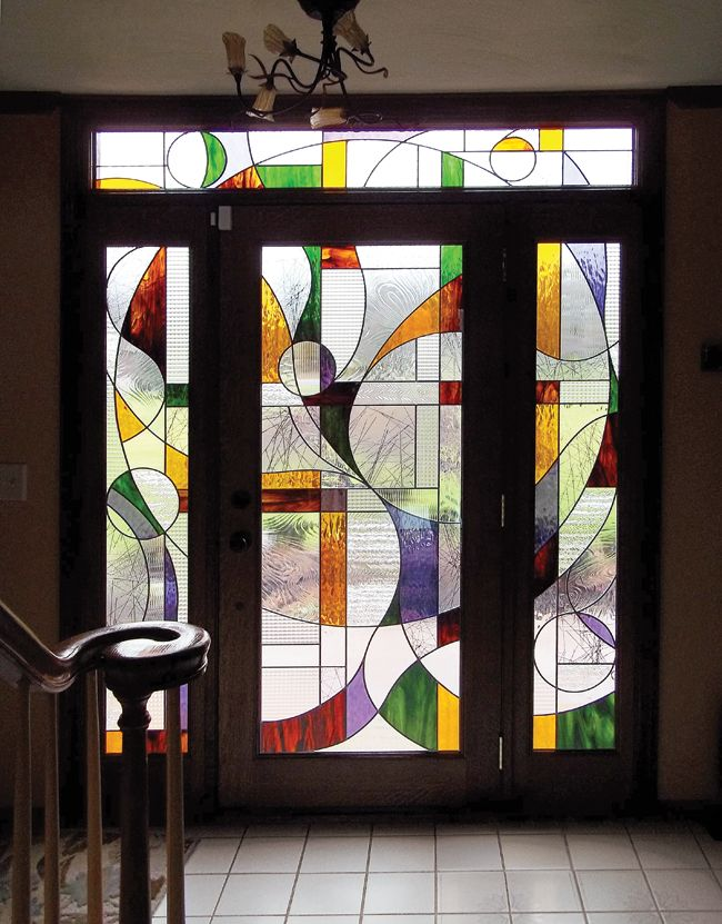 Entry Doors Are Flanked By Colorful Stained Glass Stained Glass Door Stained Glass Designs Glass Art Pictures