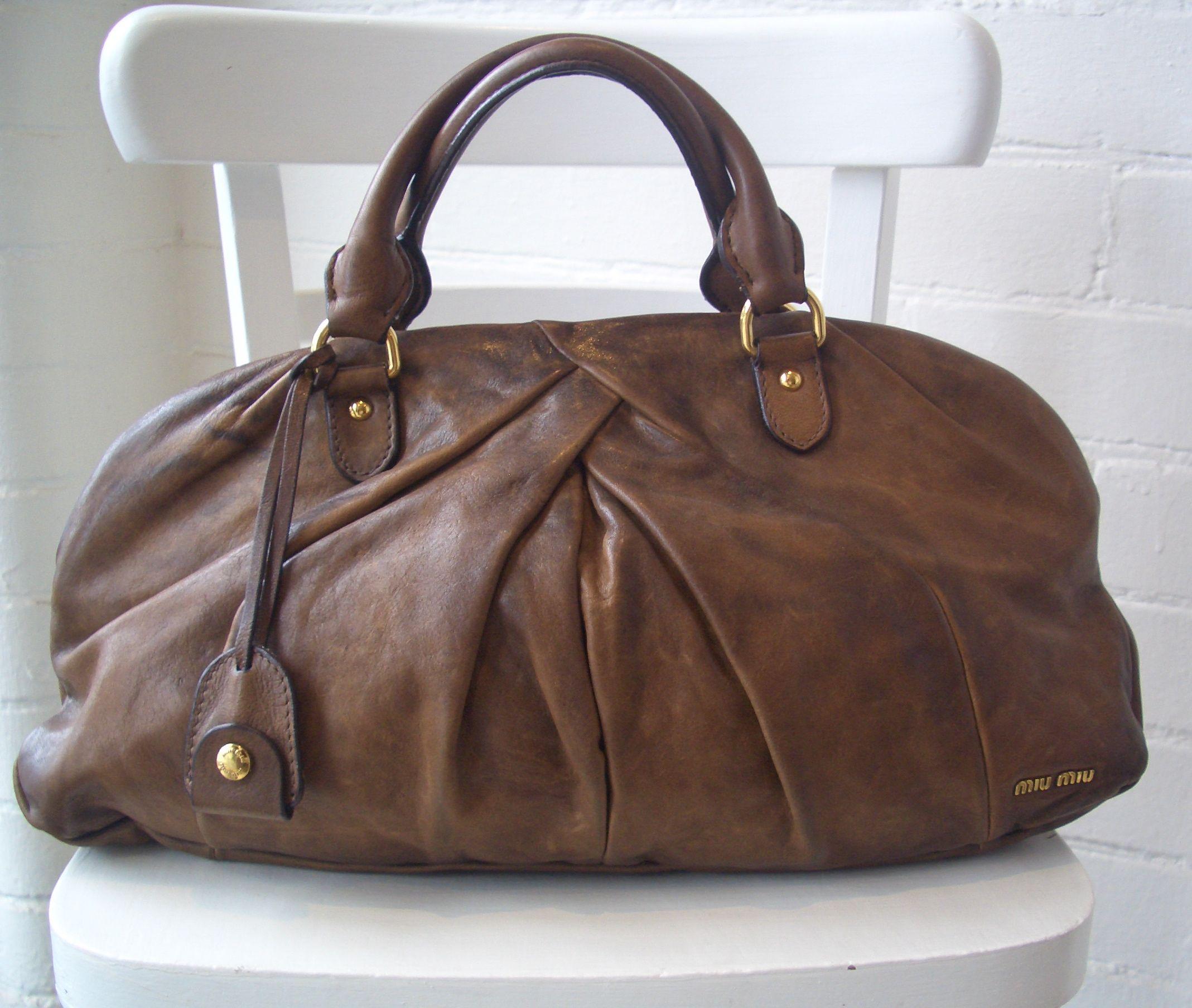 3ecc604748cb miu miu vintage bag brown with tassel and flower - Google Search ...
