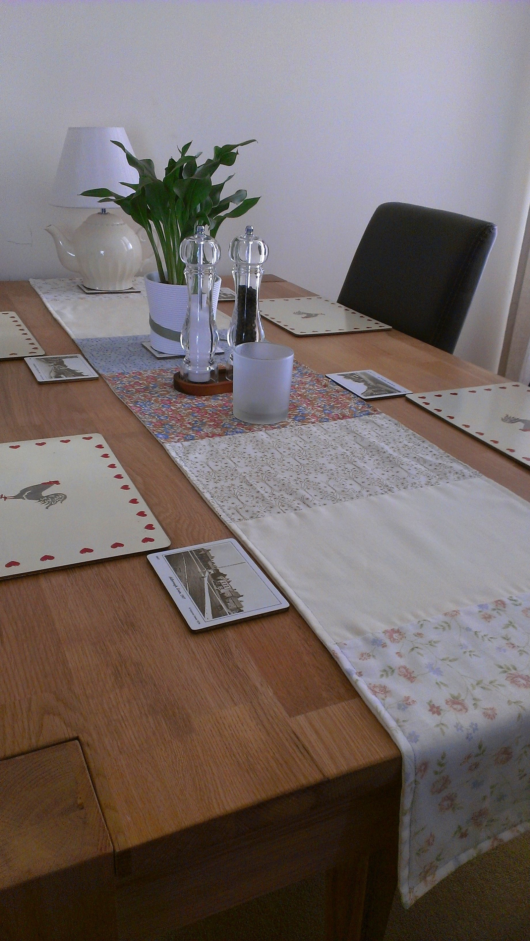 Patchwork table runner. I actually quite like it with the ends of the runner hanging off the table