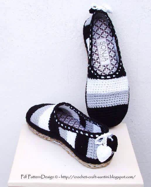 Black, white and gray slippers