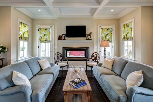 Living room with coffered ceiling, natural light and indoor/outdoor