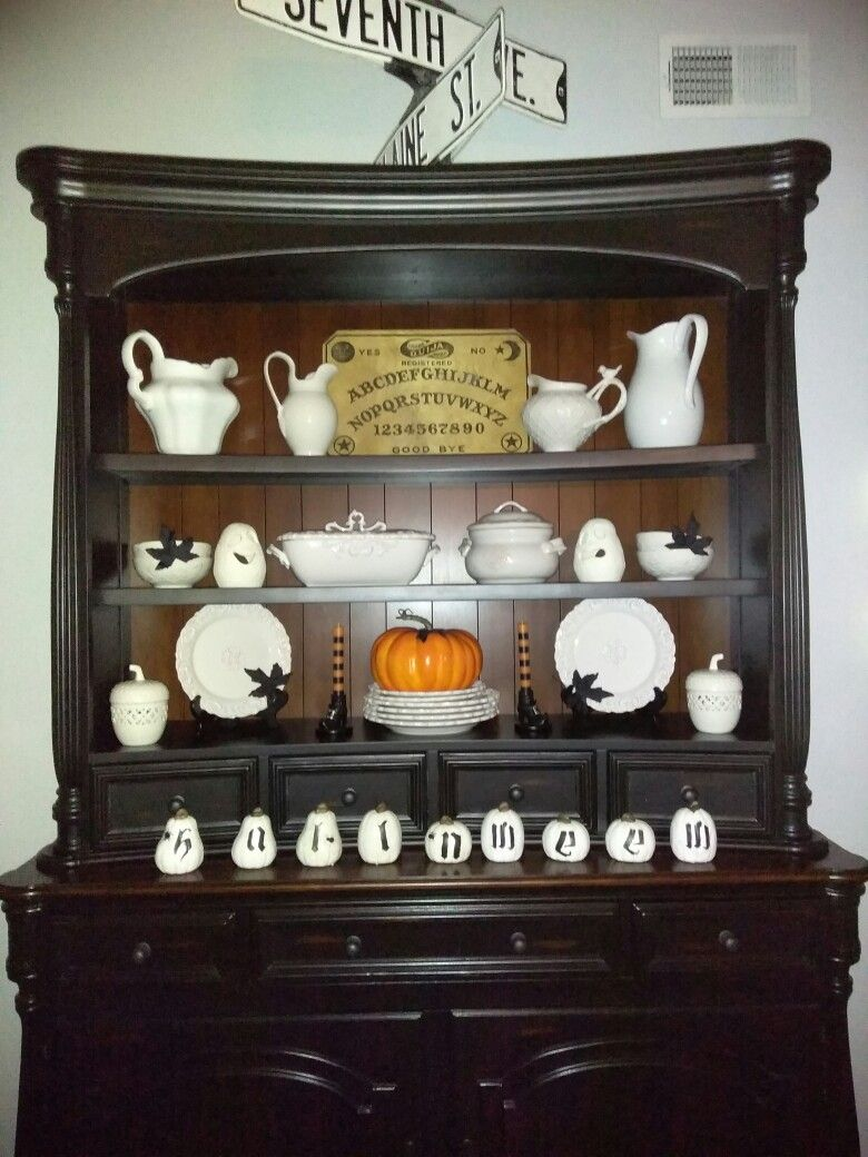 Halloween hutch decor. So much fun decorating for Halloween. Vintage ouiji board is a great touch.