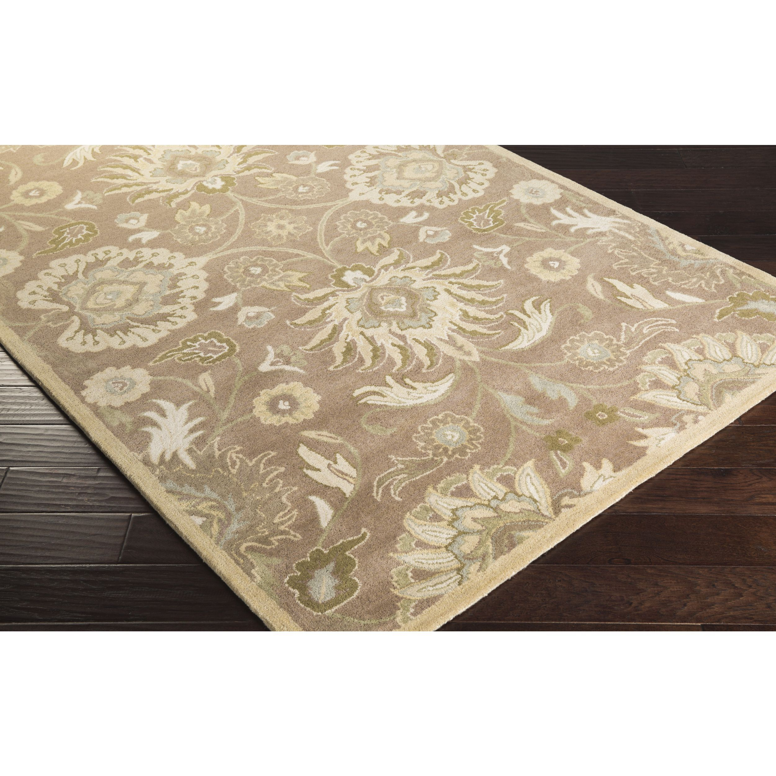 Bring luxury to your home with this traditional area rug. Hand-tufted with wool, this floral designed rug will add a pop of color and the finishing touch to your décor.