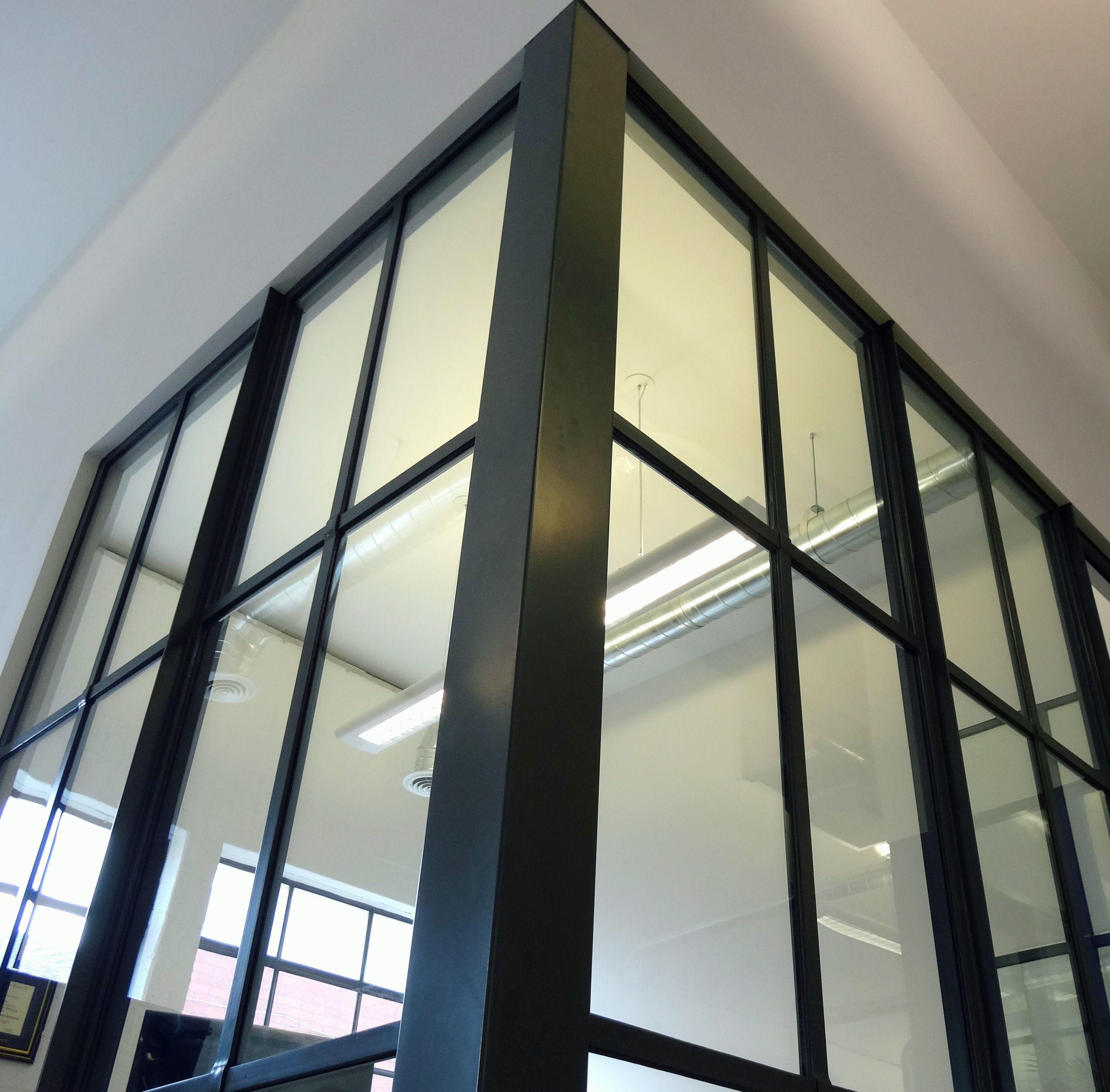 Steel Fixed Windows : Upward facing view of fixed steel window system closing