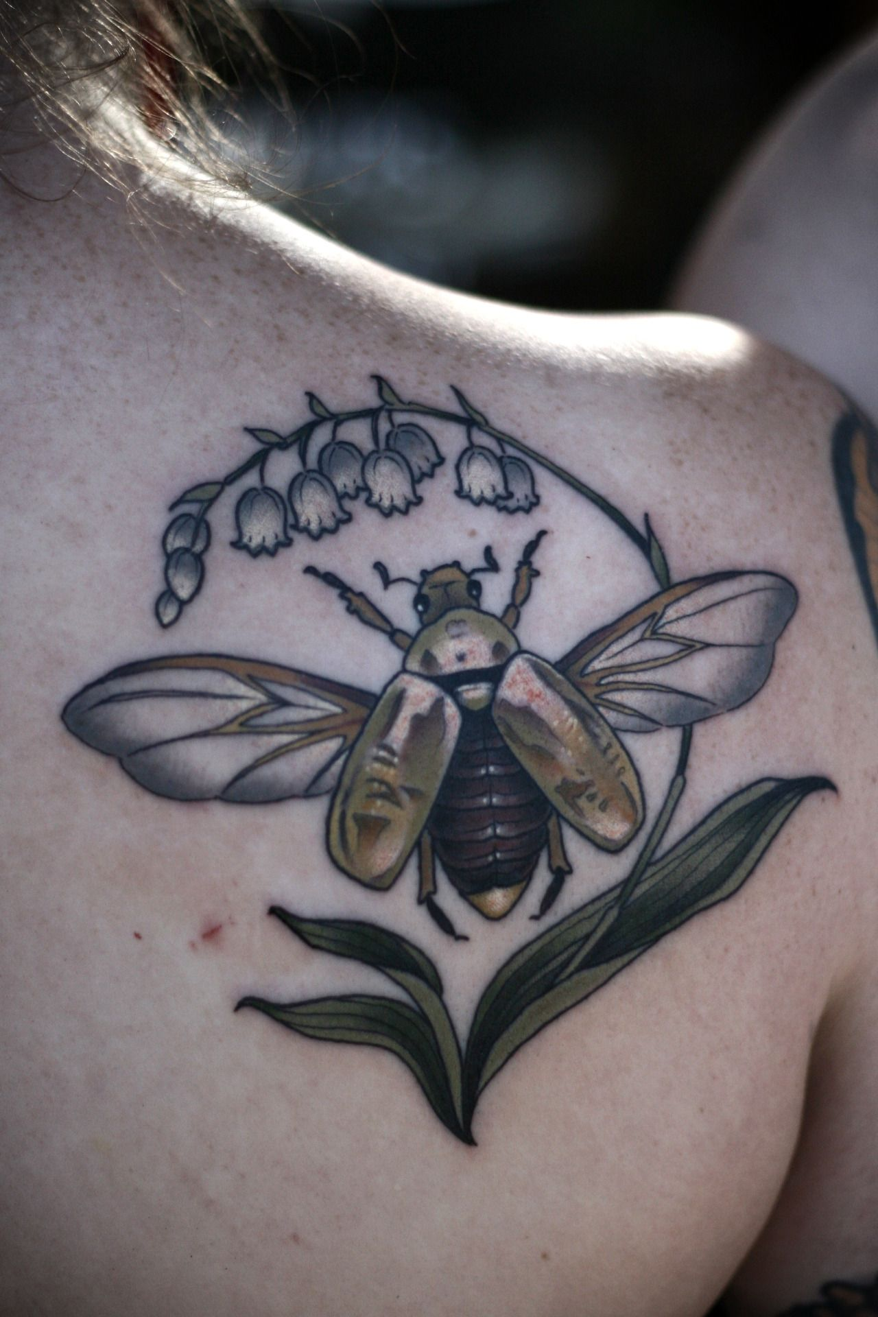 Sibling tattoos for Rachel and Justin. Jewel scarab on the