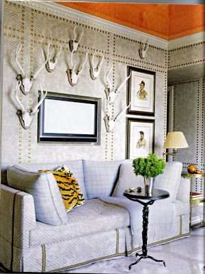if you don't have great paneling or moulding- use nail heads to add archtectural detail to a plain jane room