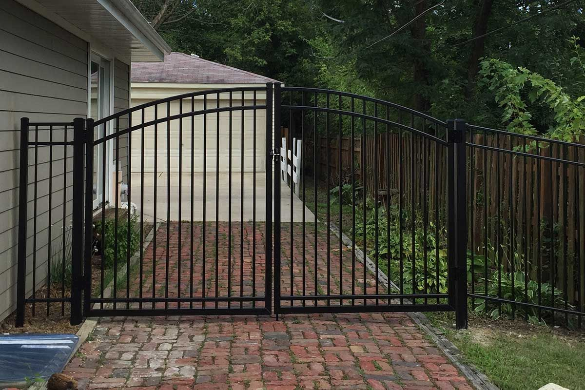 Photo of ultra aluminum arched gate across a residential for Aluminum gates for driveways