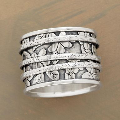 """SILVER GARDEN RING--Within the borders of a sterling silver garden, three bands twirl about at will. Handcrafted exclusively for us. Whole sizes 5 to 9. 9/16""""W."""