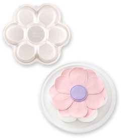 "daisy cake pan - Create a sweet flower for your little birthday fairy. This aluminum cake pan holds your favorite two-layer cake mix, and includes icing recipes and decorating tips. Measures 12"" x 12"" x 2""."