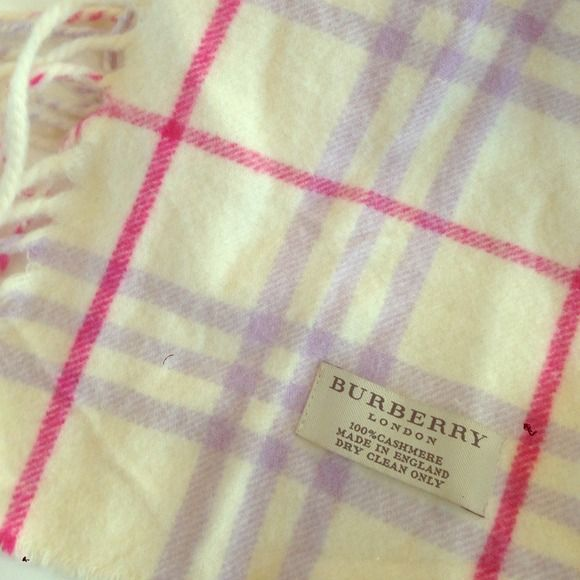 "Burberry Happy Scarf in Pink/Purple Check The limited edition ""Happy"" scarf from Burberry is 100% cashmere and features fringe from top to bottom on both sides of the scarf. It measures 55 in' long. It has only been used a few times and has just come back from the dry cleaner! So soft! Burberry Accessories Scarves & Wraps"