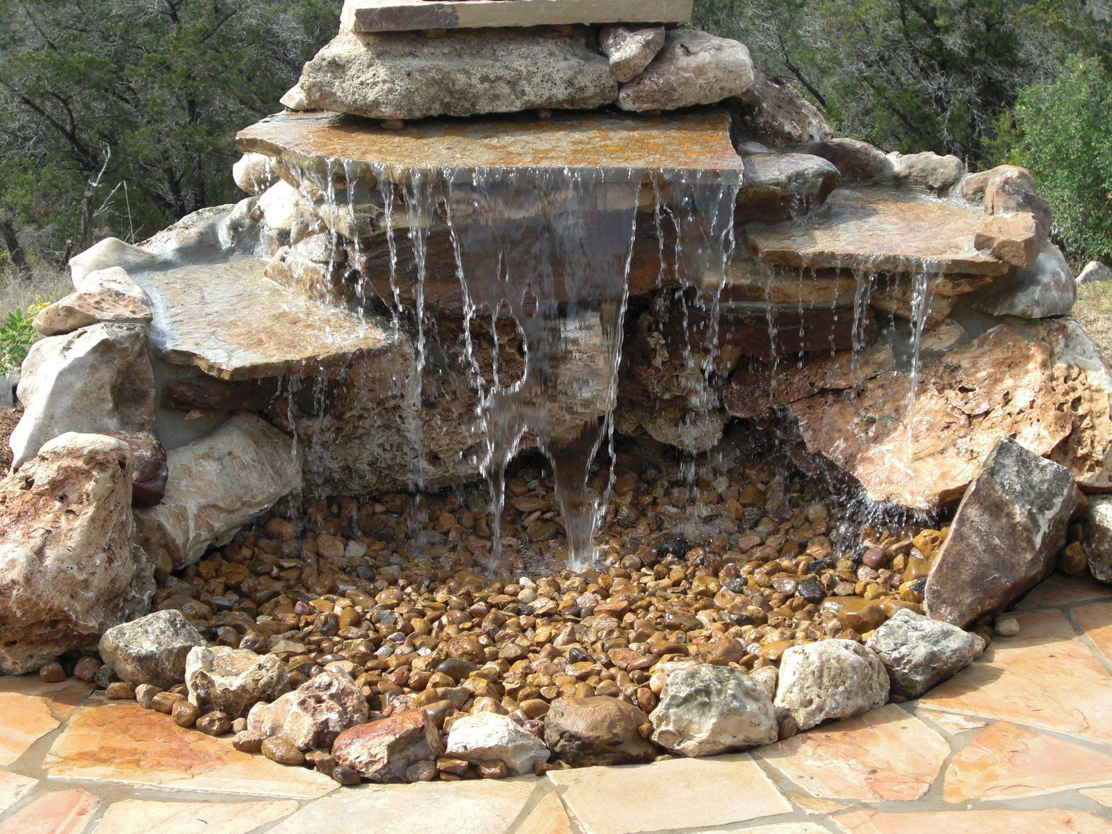 Small backyard ponds and waterfalls - Adorable Minimalist Pond Less Waterfall With Small And Large Rocks Design For Small Backyard Outdoor Design