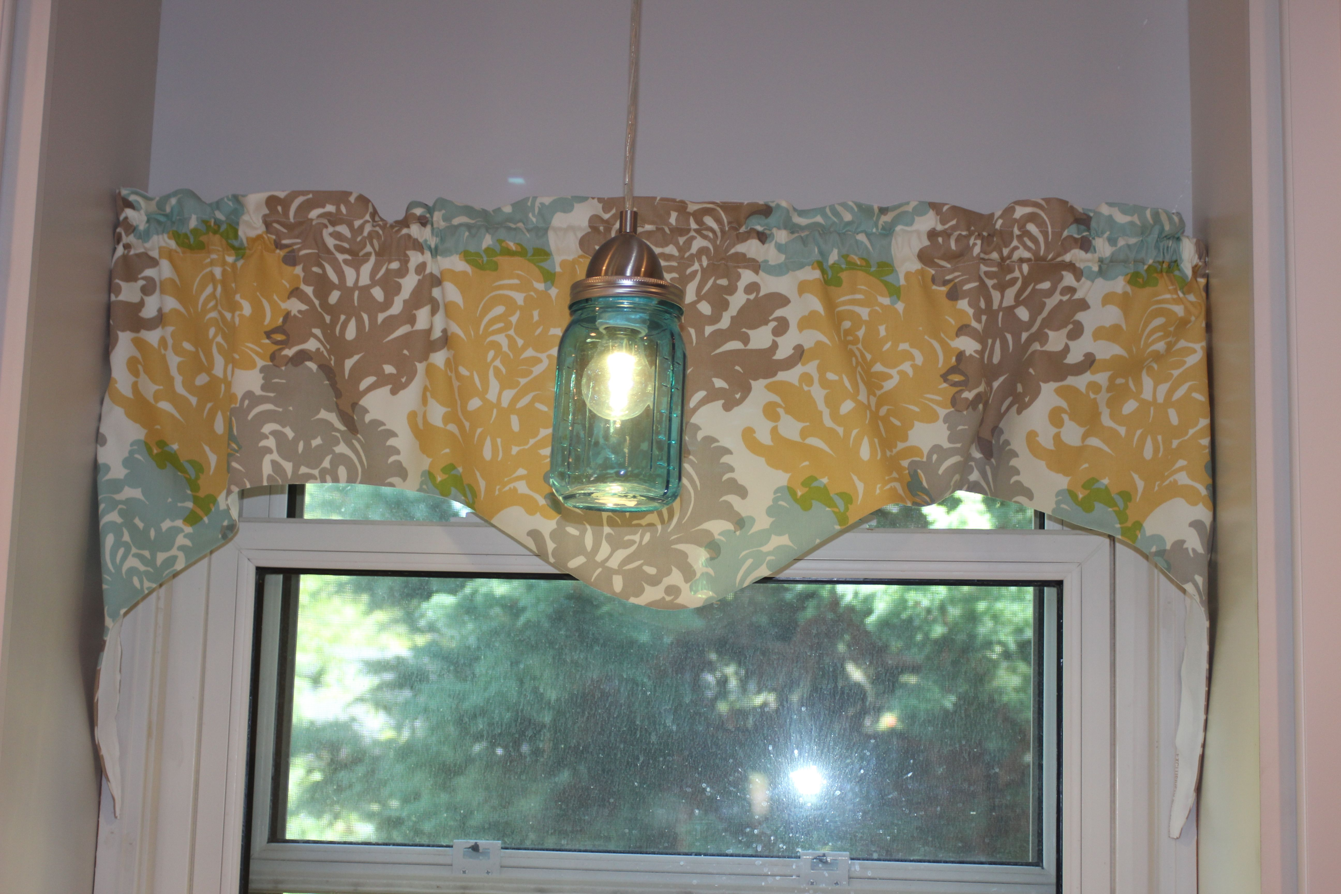 Homemade valance and mason jar pendant light. Thanks pinterest for the ideas, it came out great!