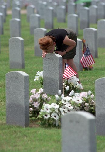 CONTACT FILED:  HOUSTON NATIONAL CEMETERY..5/27/01--Gigi Zientek leans over and kisses the grave of her father, Marion Patrick Zientek, who is buried at Houston National Cemetery on Veterans Memorial Drive. Marion Zientek was a Sp. 5 with the U.S. Army's combat engineers.     HOUCHRON CAPTION (05/28/2001):  Gigi Zientek kisses the marker on the grave of her father, Army veteran Marion Patrick Zientek, on Sunday at the Houston National Cemetery.  Memorial Day ceremonies will be held there…