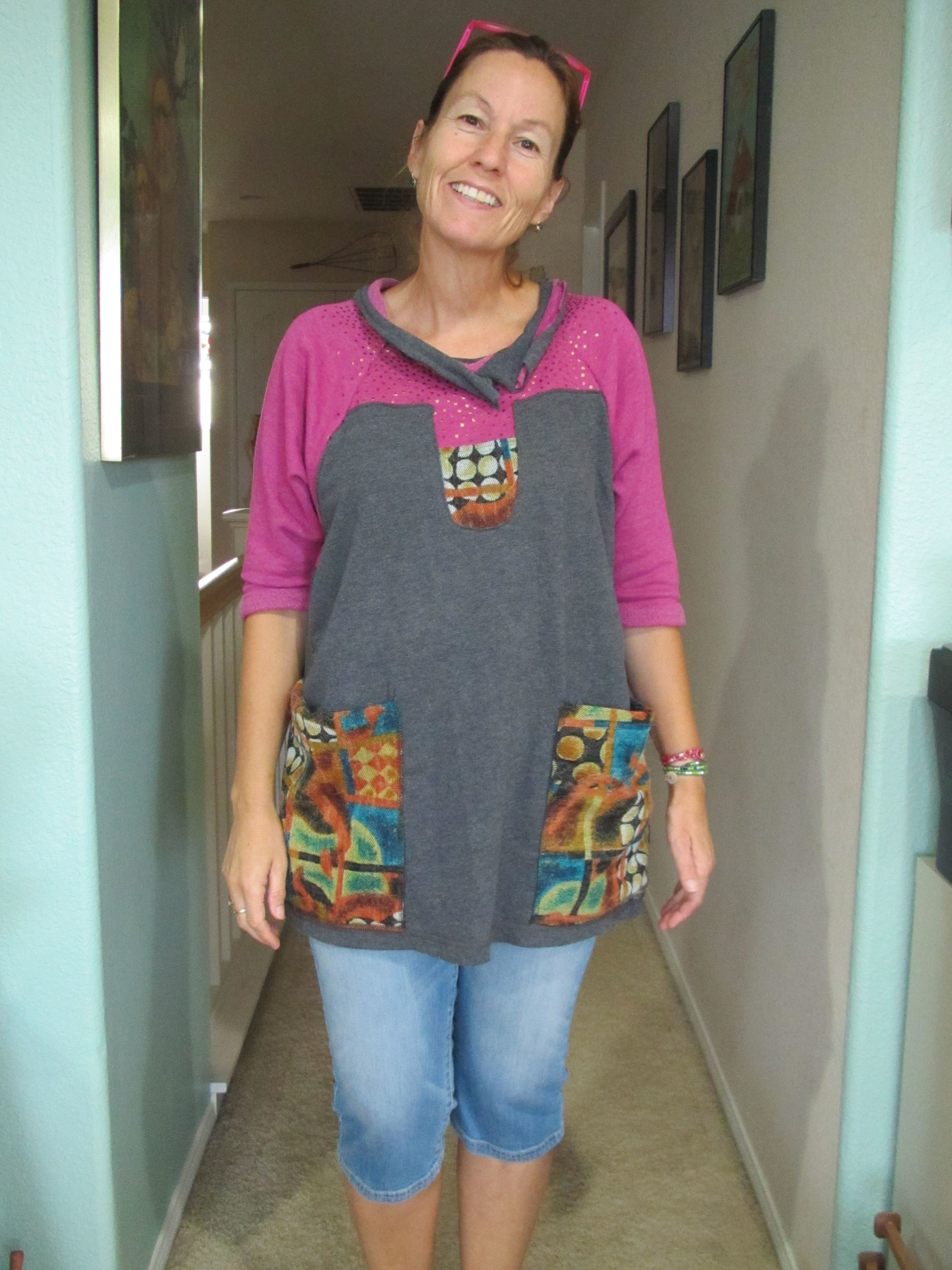 made this tunic from two thrifted shirts and 1/4 yd of colorful fabric.  This was inspired by a pinterest pin by Diane Ericson.