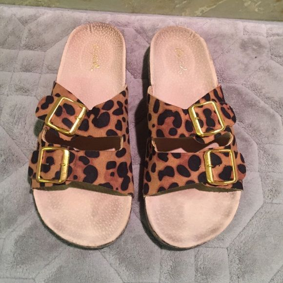 Trendy worn once animal print slides Soooo cute! I hate to sell these but they are just a smidge too small. I tried to wear them once or twice but it just didn't work :( I am normally a 7 but I would say these are better as a 6.5 Qupid Shoes Sandals