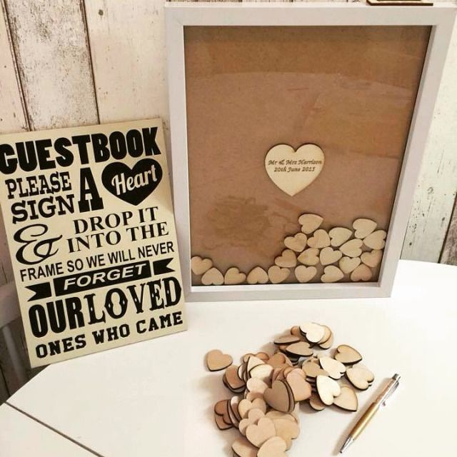 Have Guests Sign A Wood Heart And Drop It Into Your Plinko Style Wedding Guestbook That