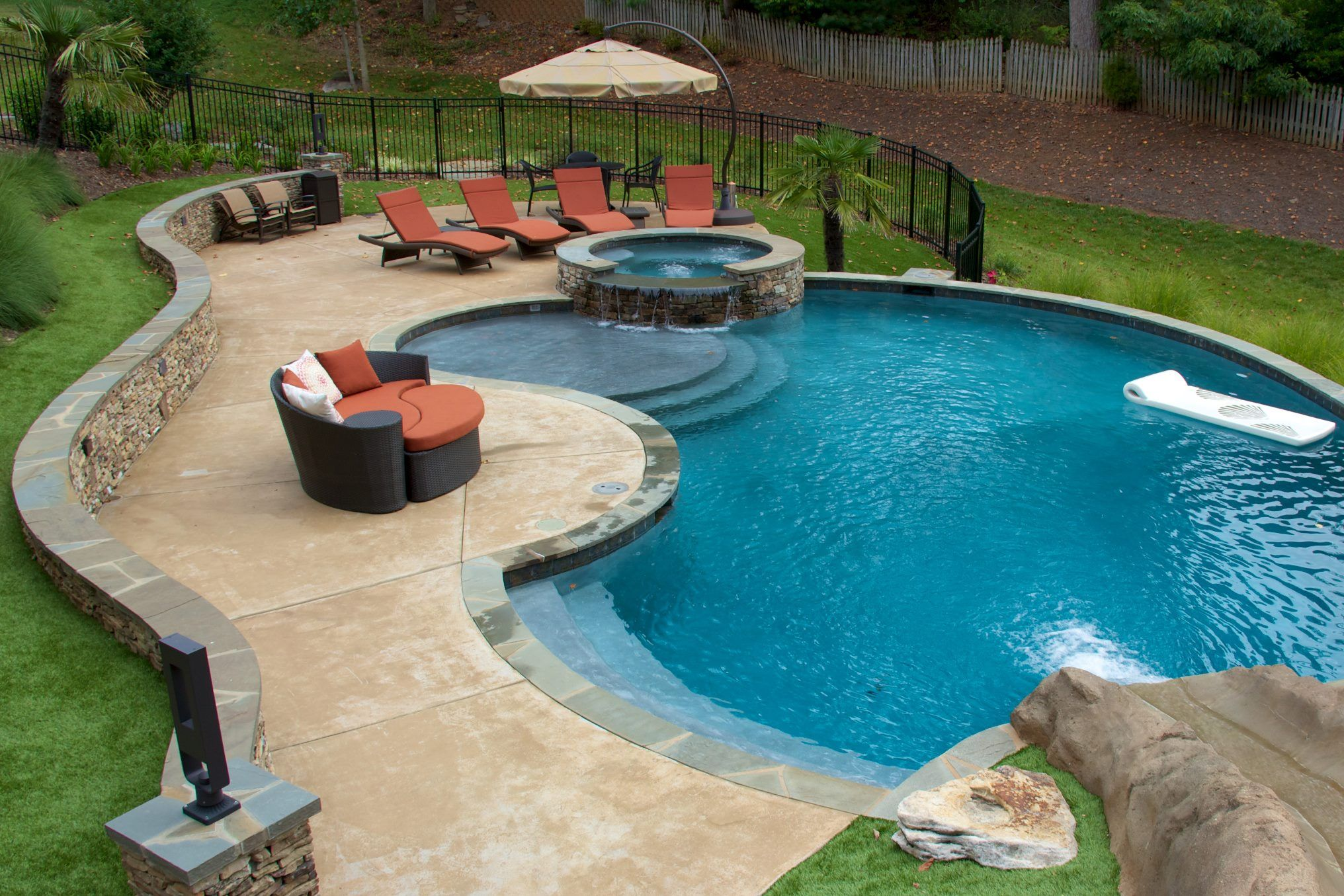 Complimented by the freeform curved design of jennifer s for Garden oases pool entrance