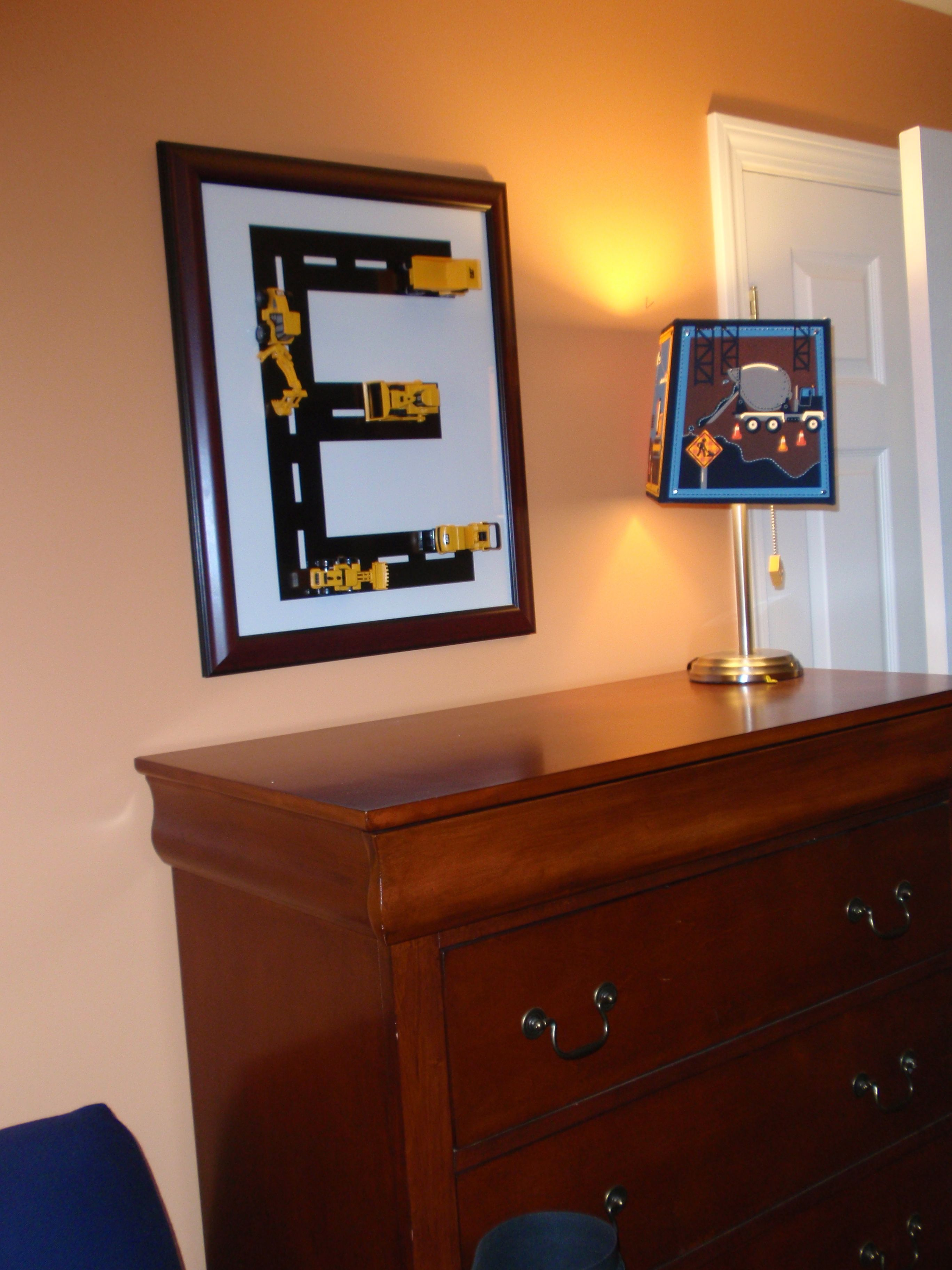 Construction themed toddler boy's room. 3D wall art: Mighty Machines construction trucks glued to