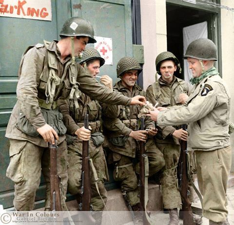 Members of the 101st Airborne Division enjoying cigarettes
