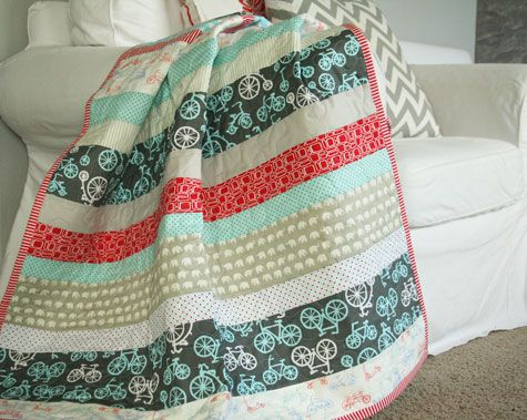 quick and simple baby quilt - just strips of various fabrics - would be easy to do this in the quilt as you go style - especially a small baby quilt
