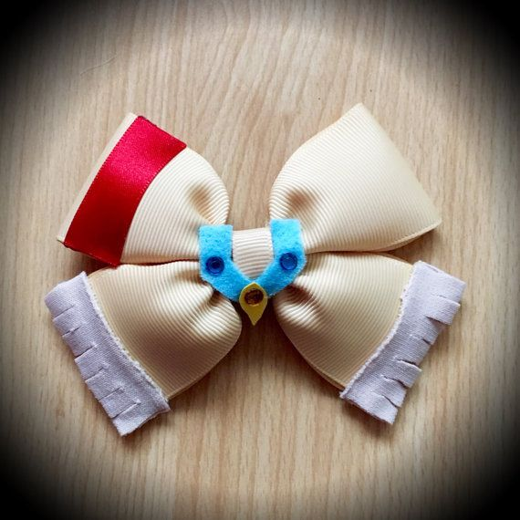 Pocahontas Character Inspired Disney Princess Hair Bow Beige Grosgrain Ribbon Decorated with Red Satin Ribbon and Beige Elastine Fringe and Felt Necklace with Rhinestones Centrepiece. Mounted on an alligator clip. I can do custom bows, just let me know if youd like something specific. Price is for single bow.