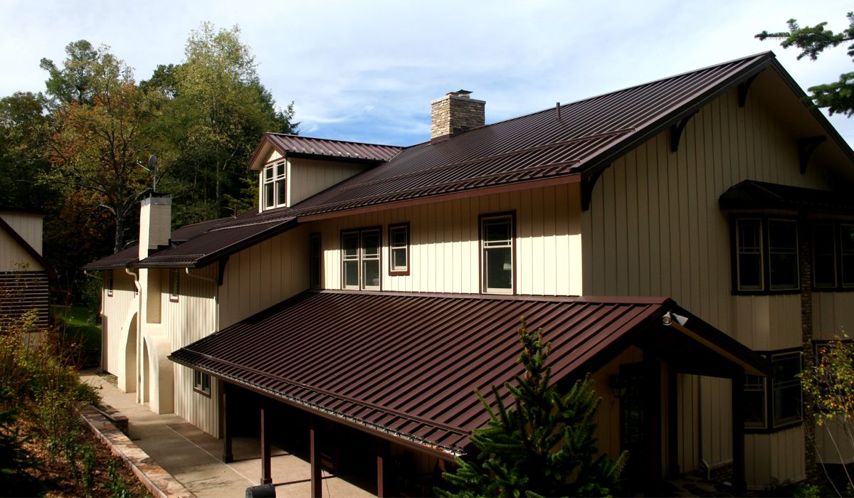 Atas monarch batten seam roof in classic bronze vertical metal