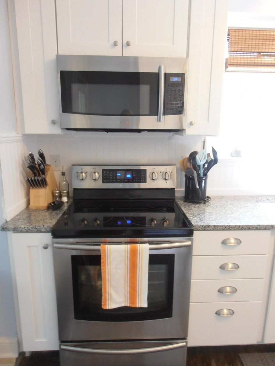How To Install An Over The Range Microwave With No Cabinet Shelves Modern Chrome Electric Stove In White Apartment