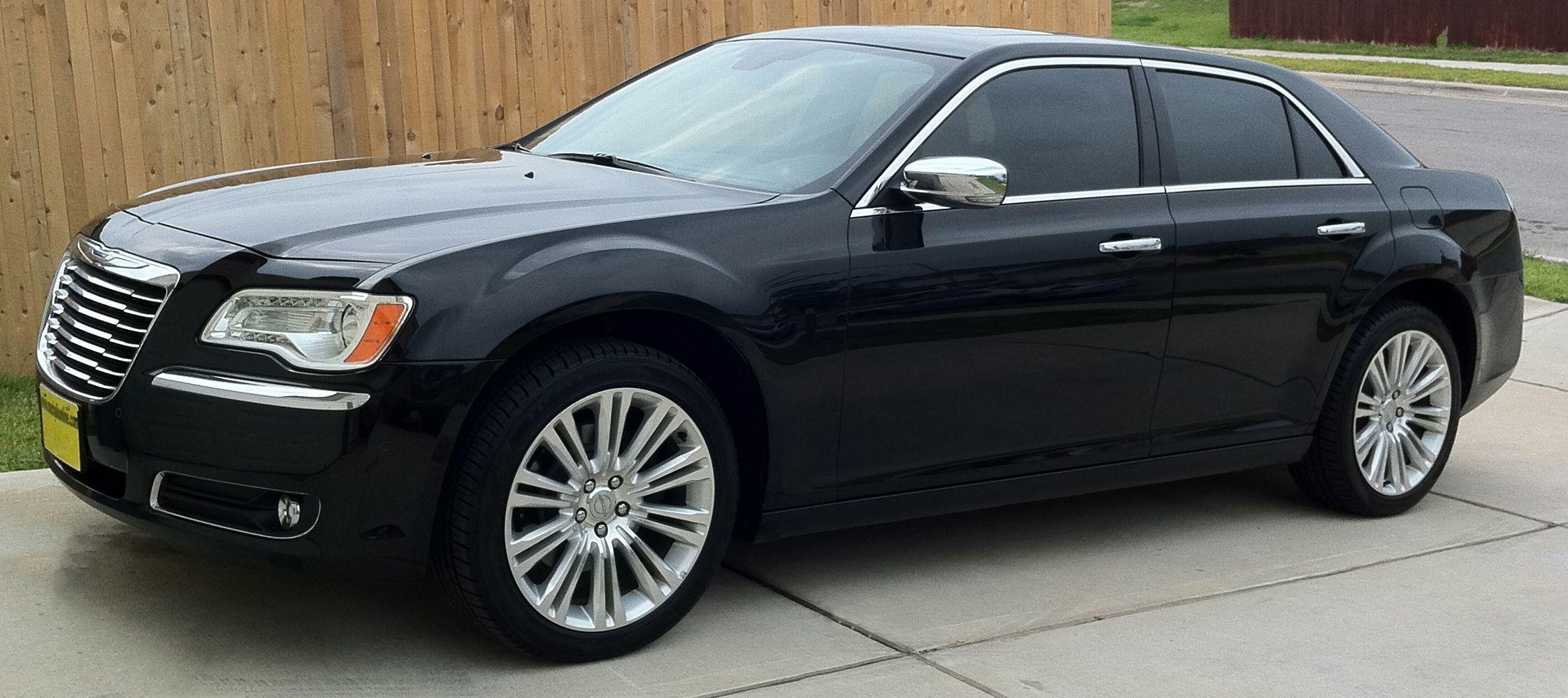 Black chrysler 300 with blue stripe dream cars pinterest chrysler 300 cars and chrysler 300c
