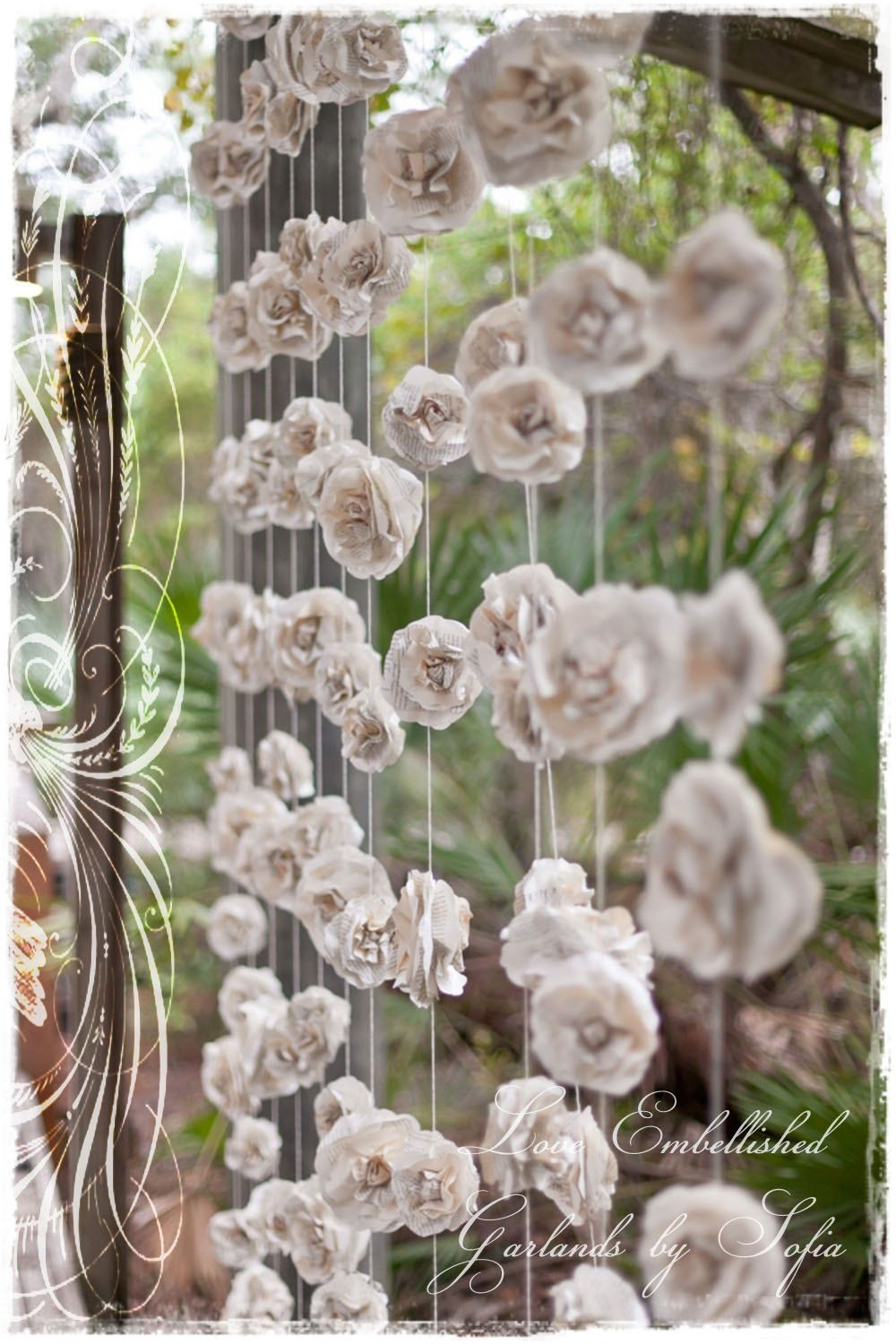 A curtain of twelve garlands create a stunning backdrop for your paper flowers in some places a curtain of 12 garlands wedding garland paper flower roses backdrop fills x area made with vintage book pages gorgeous dhlflorist Image collections