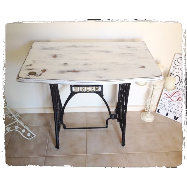 Distressed sewing table.
