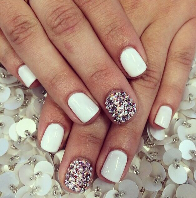 White gel manicure with Swarovski crystals