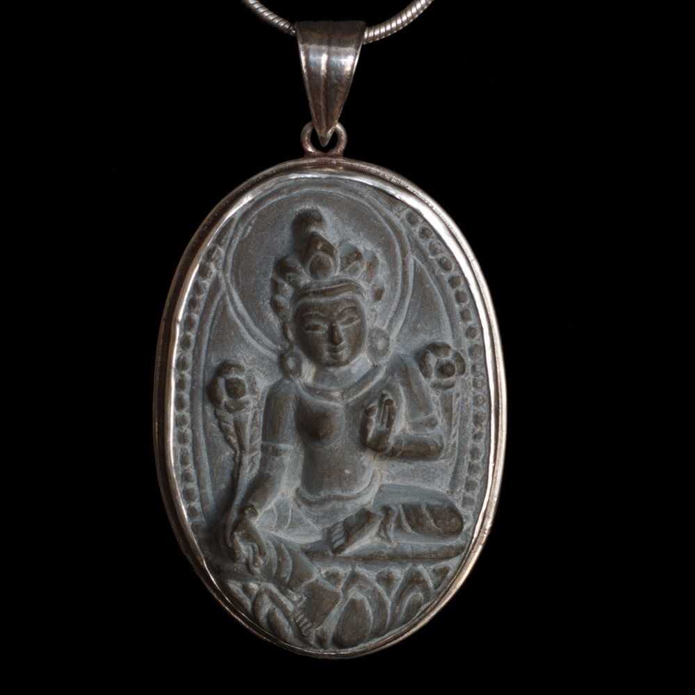 Silver pendant from sandstone with green tara symbol in buddhist silver pendant from sandstone with green tara symbol in buddhist religious practice green taras primary role is savioress she is believed to help her mozeypictures Gallery