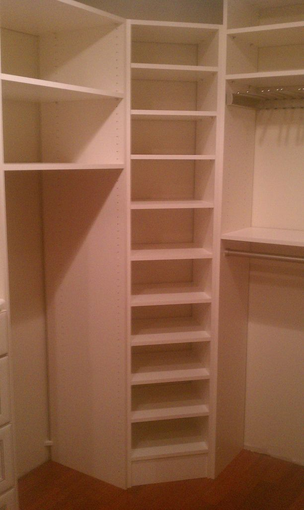 Corner Storage In The Closet For Folded Clothes Shoes