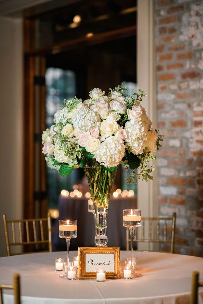 Tall round centerpiece - ivory roses, white hydrangea ...