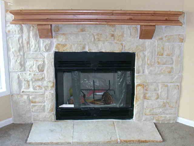 Austin stone fireplace not this mantle for sure like the low